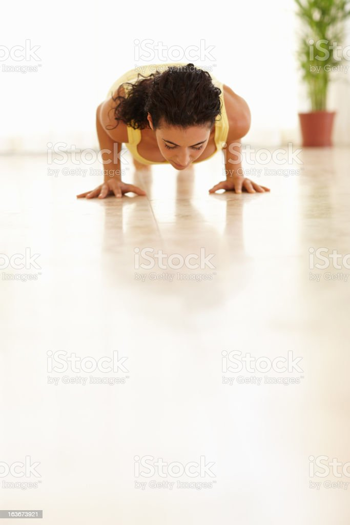 Doing push-ups to work her upper body royalty-free stock photo
