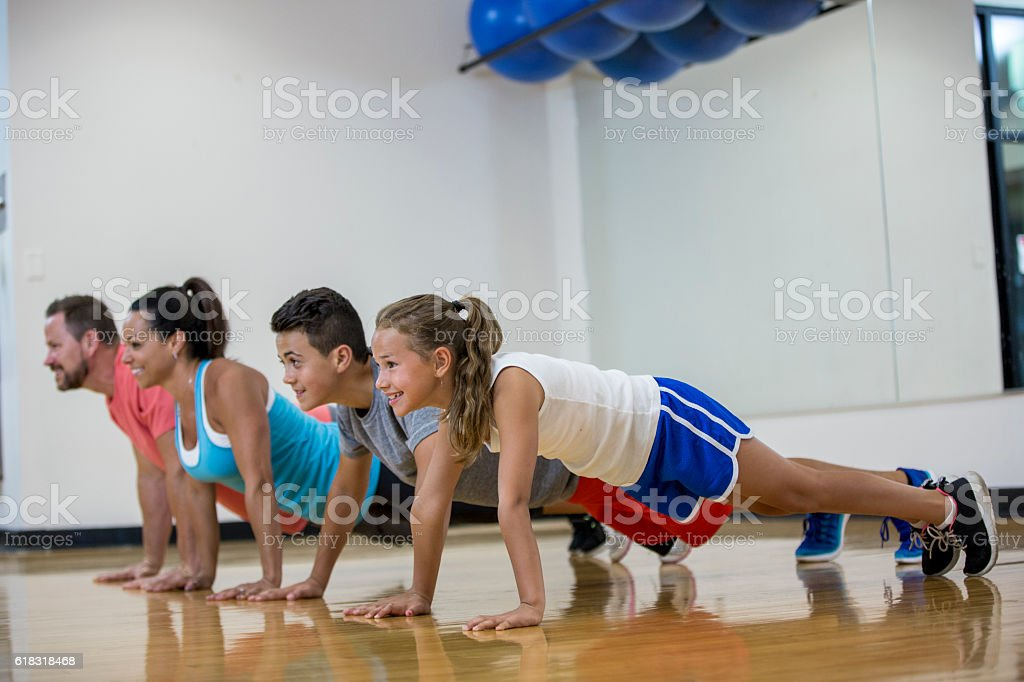 Doing Push-Ups Together stock photo