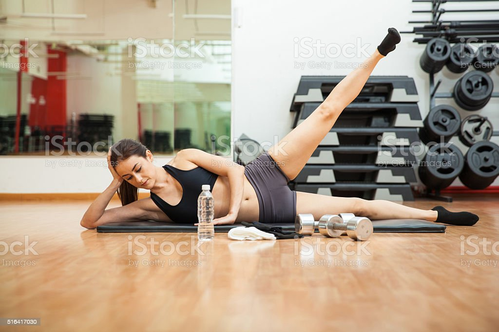 Doing side crunches at the gym stock photo
