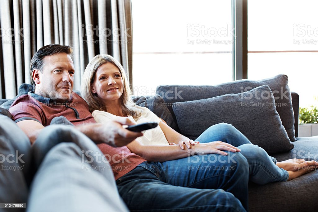 Doing some channel surfing stock photo