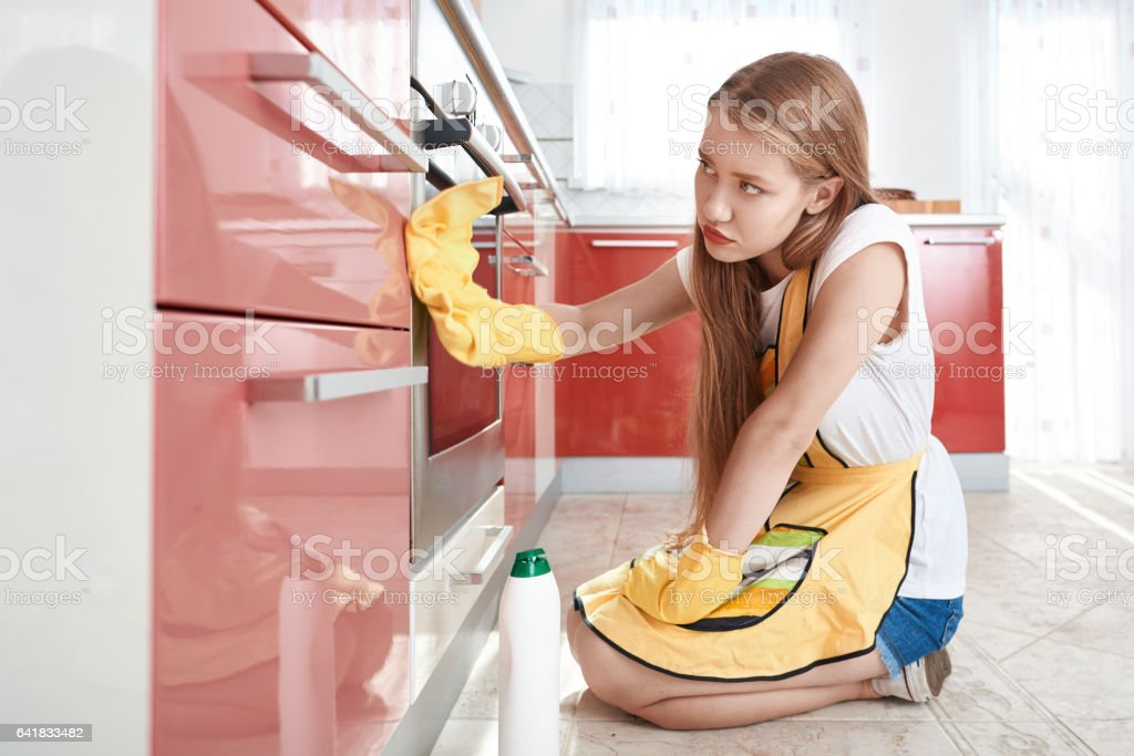 doing some cleaning in the kitchen stock photo