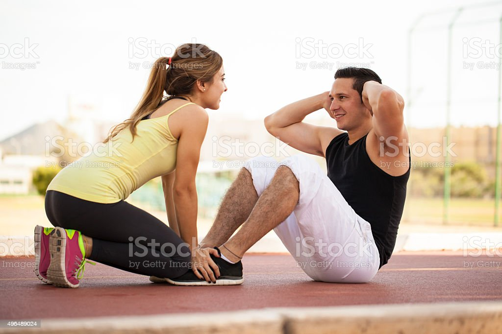Doing some crunches together stock photo
