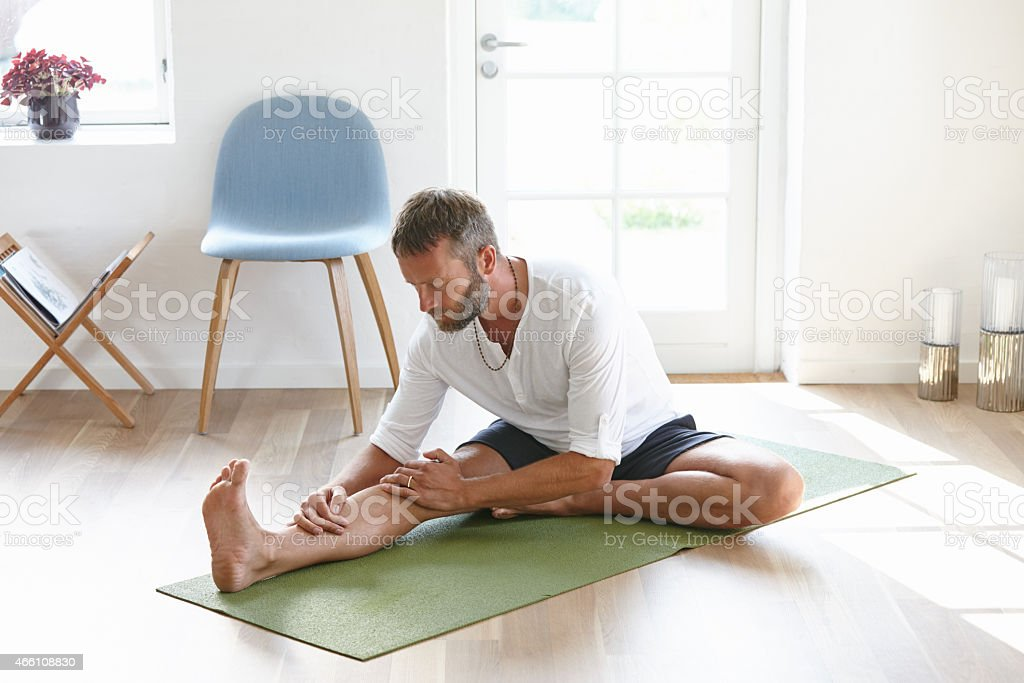 Doing some deep stretching stock photo
