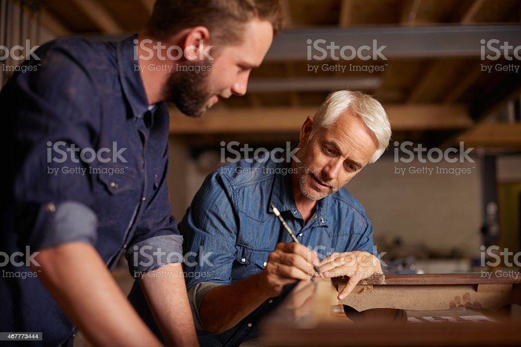 Doing some DIY with dad stock photo