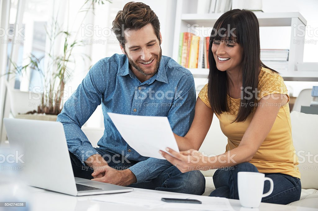 Doing some online banking at home stock photo
