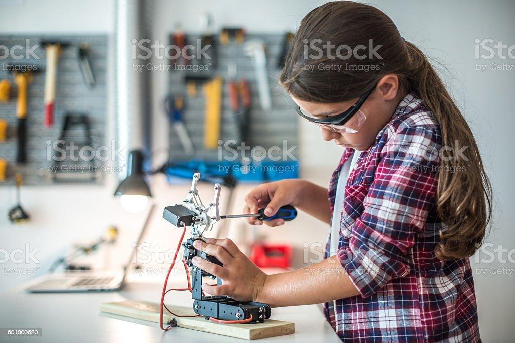 Doing some robotics stock photo