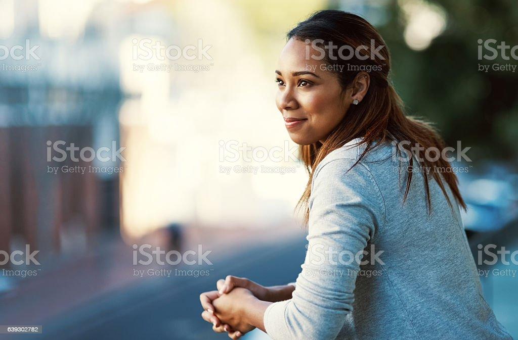 Doing some thinking on the balcony stock photo