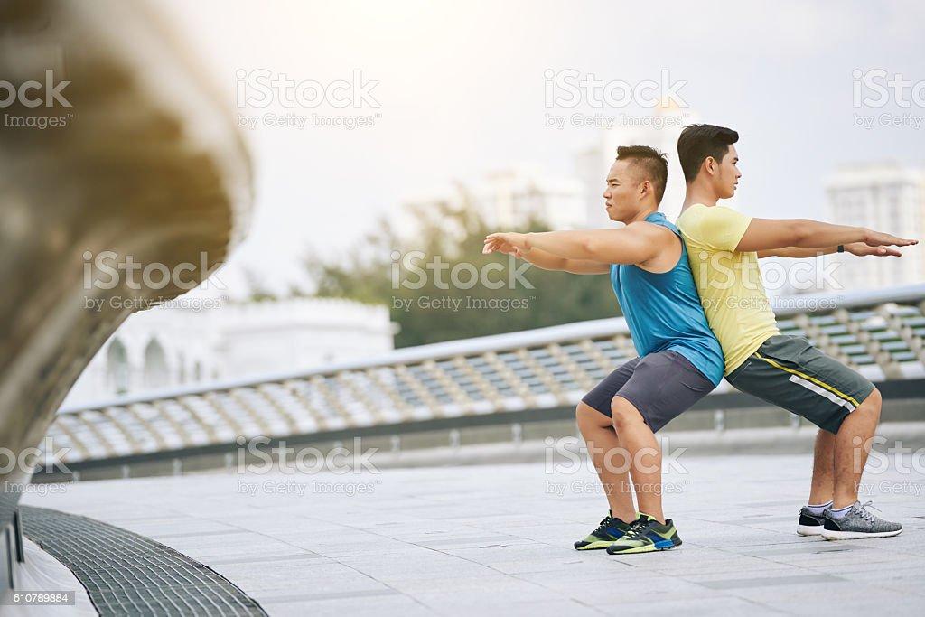 Doing squats stock photo