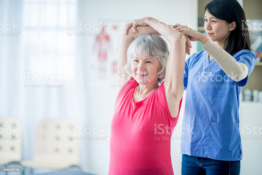 Doing Stretches for Back Problems stock photo