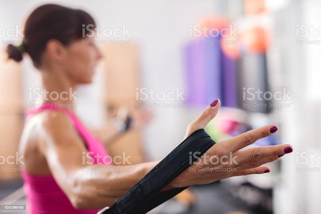 Doing stretching exercises on Pilates machine. stock photo