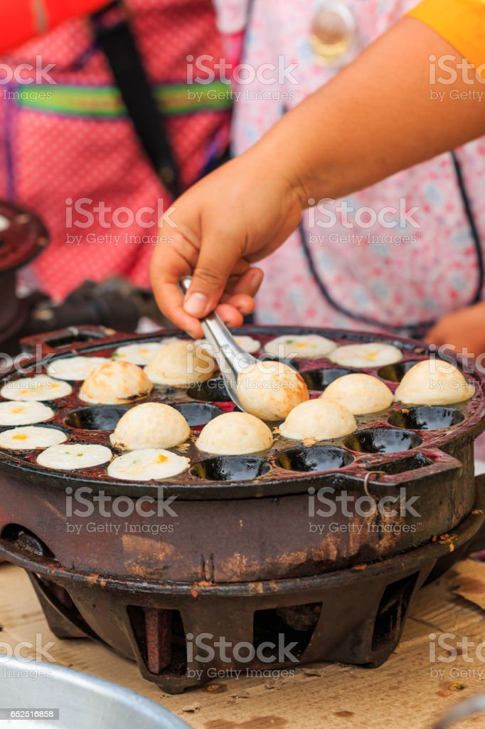 Doing Thai traditional  dessert, coconut milk with powder fried stock photo