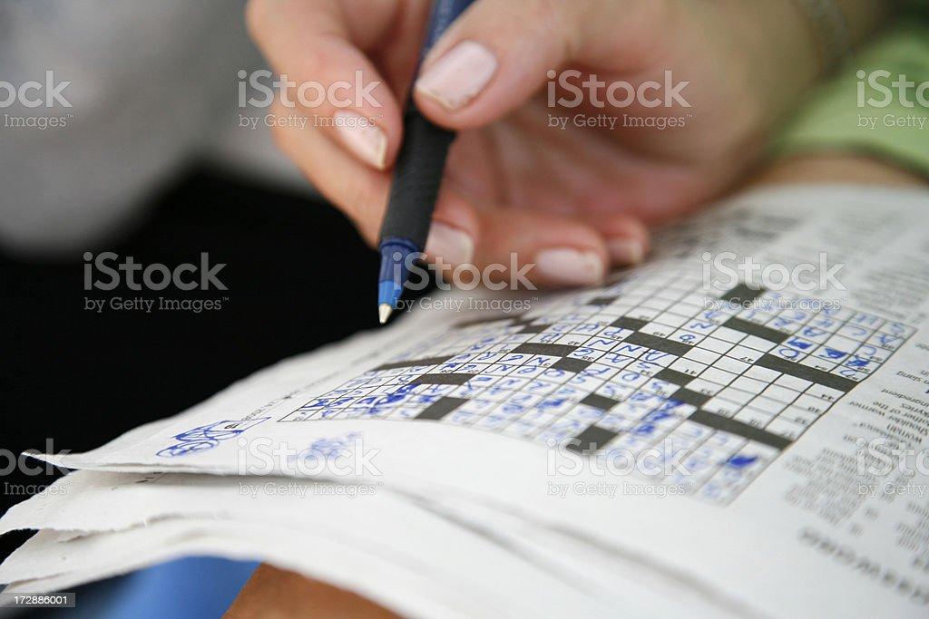 Doing the crossword puzzle stock photo