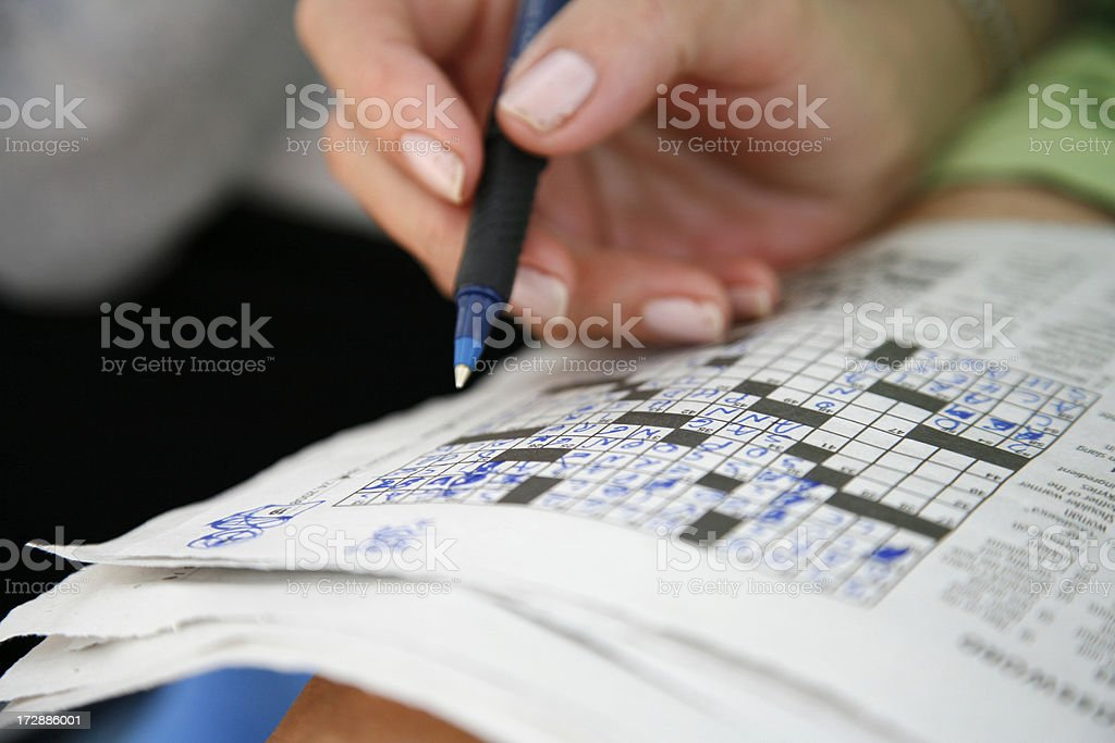 Doing the crossword puzzle stock photo
