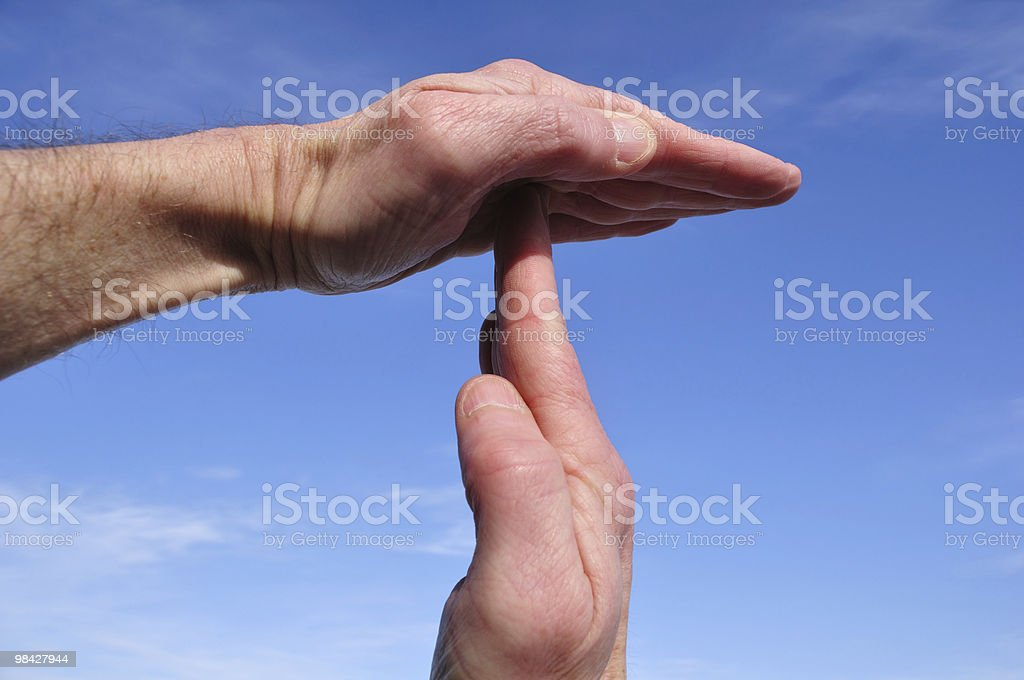 Doing Time Out Signal with Hands stock photo