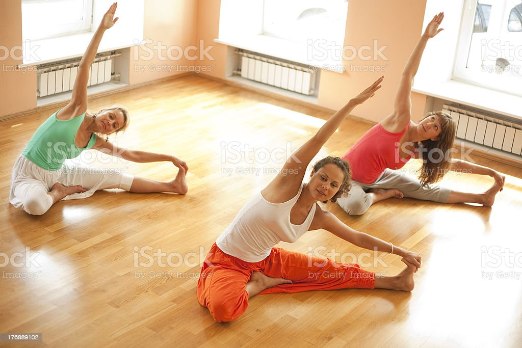 Doing yoga in health club royalty-free stock photo