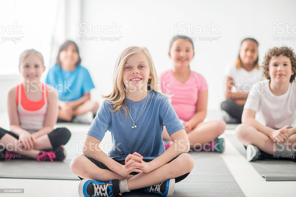 Doing Yoga in Physical Ed Class stock photo