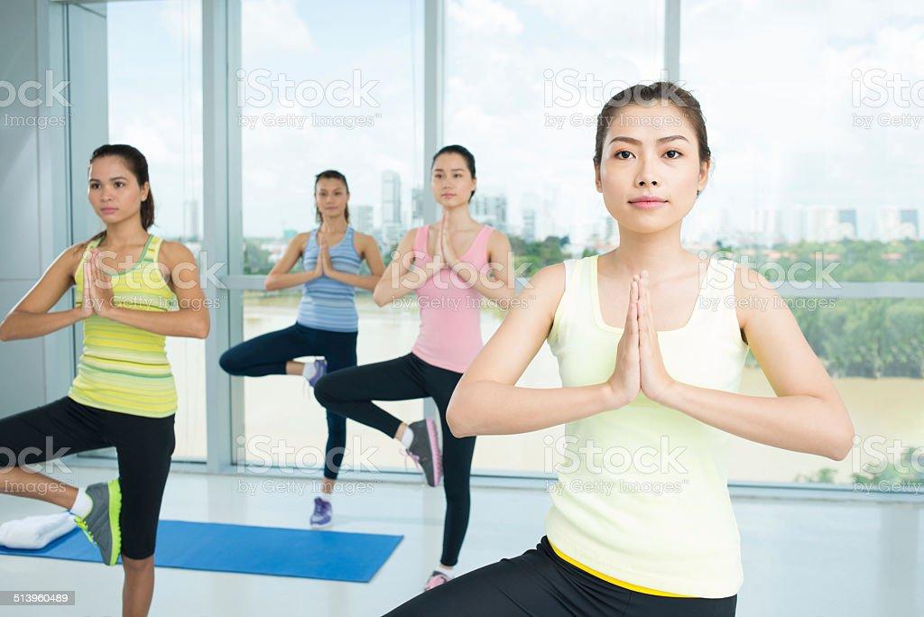 Doing yoga position stock photo