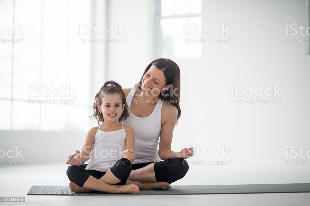Doing Yoga Together on Mother's Day stock photo