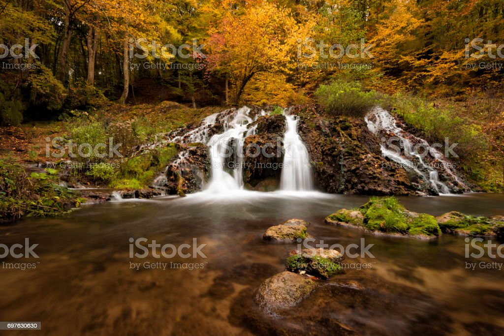 Dokuzak waterfall in Strandja mountain, Bulgaria during autumn. Beautiful view of a river with an waterfall in the forest. Autumn landscape stock photo