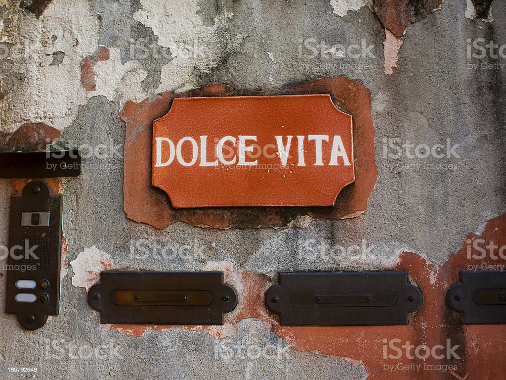Dolce Vita sign on an old Wall stock photo