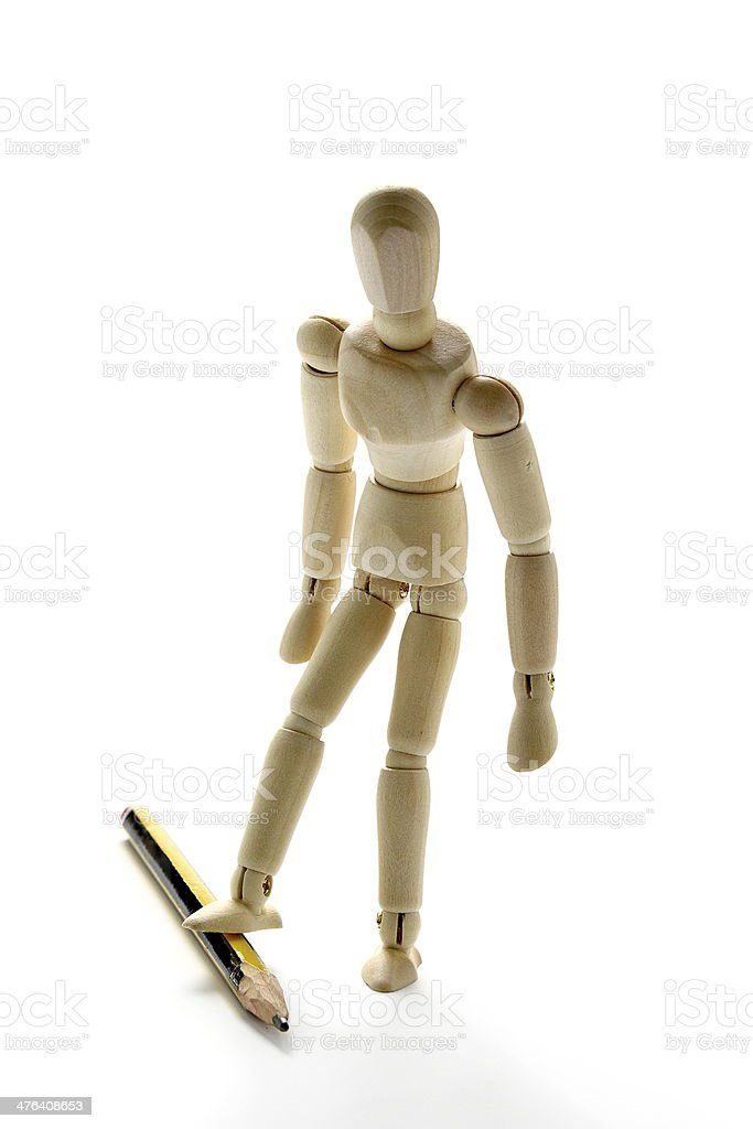 Doll and pencil stock photo