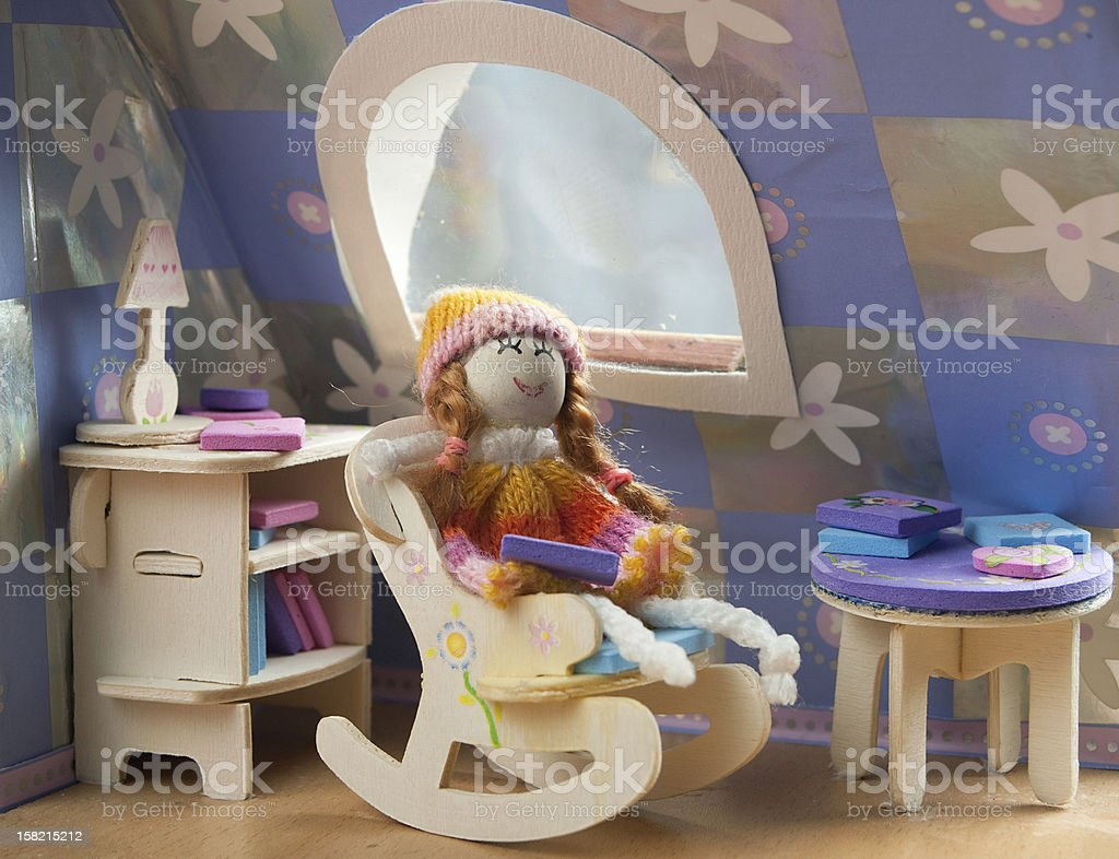 doll in a chair stock photo