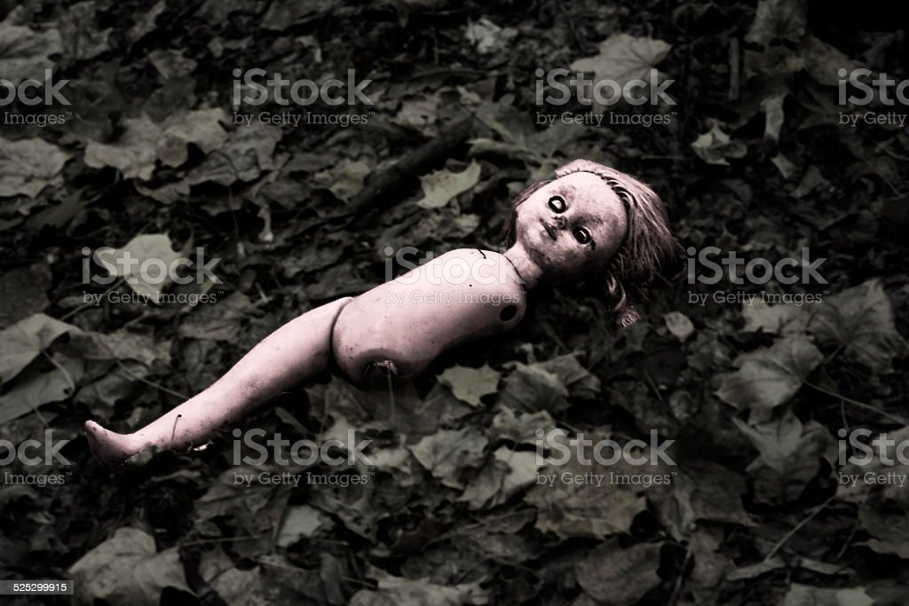 Doll in forest stock photo