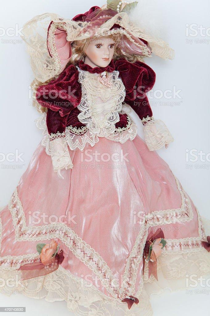 Doll lady in elegant velvet dress stock photo
