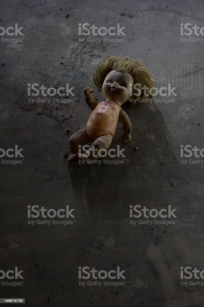 doll lying on the dust stock photo