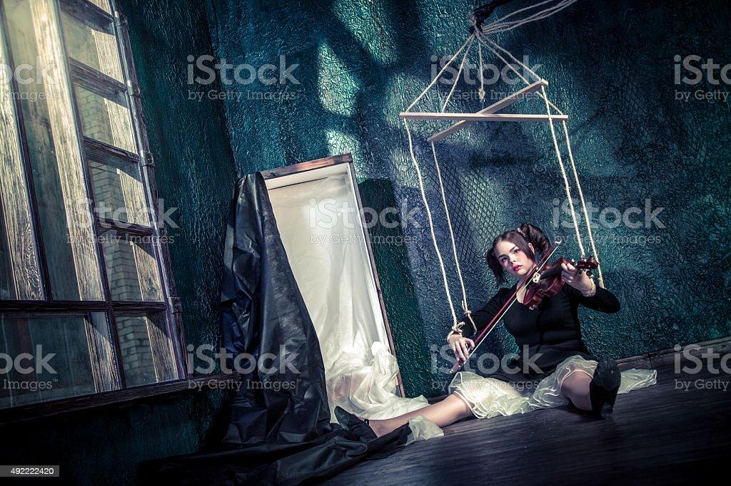 Doll Violin Player stock photo