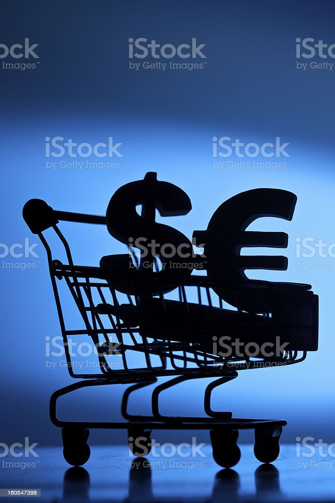 Dollar and Euro currency symbol in shopping cart royalty-free stock photo