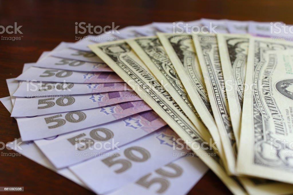 dollar and grivnas banknotes stock photo