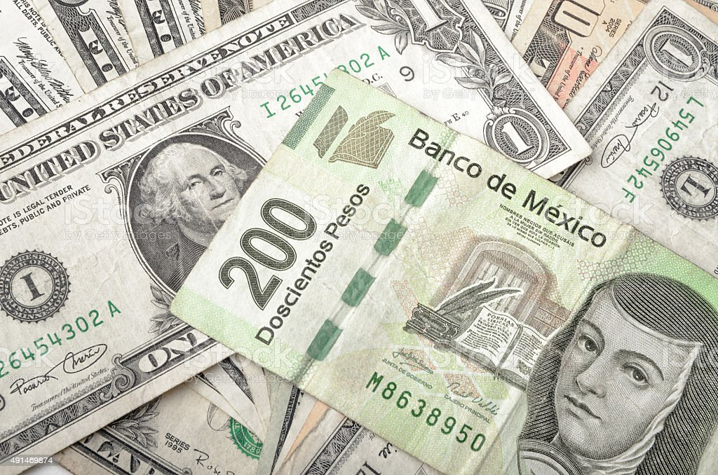Dollar and Mexican Pesos Bills stock photo