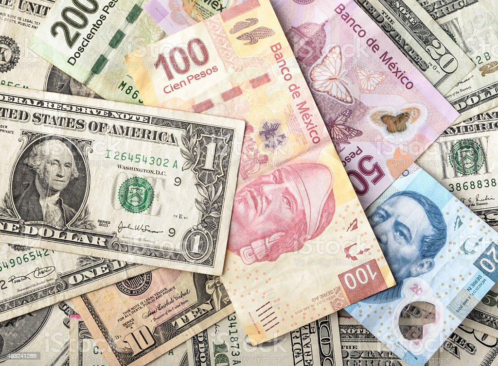 Dollar and Mexican Pesos Bills stock photo