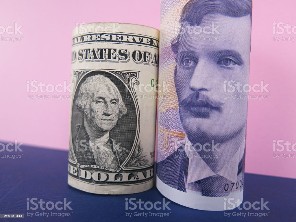 US dollar and Norwegian krona banknotes stock photo