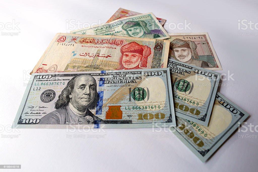 US dollar and Omani Riyal isolated on white background stock photo