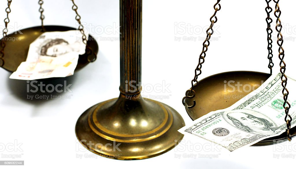 Dollar and Pound notes on scale stock photo