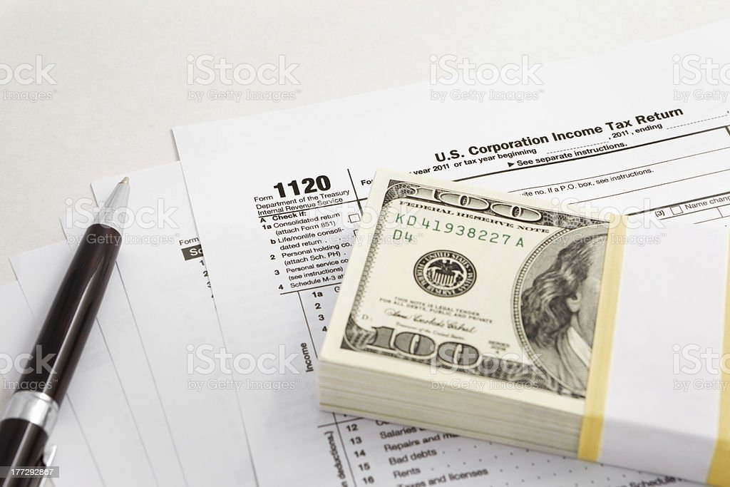 Dollar and tax forms royalty-free stock photo