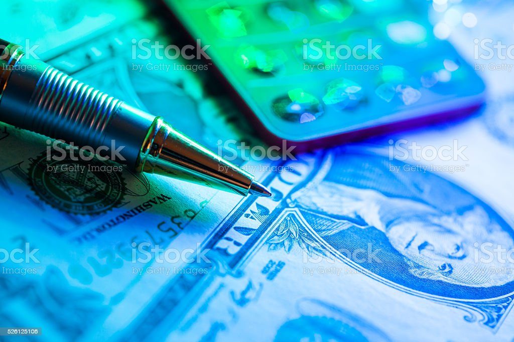 dollar background under light with pen stock photo