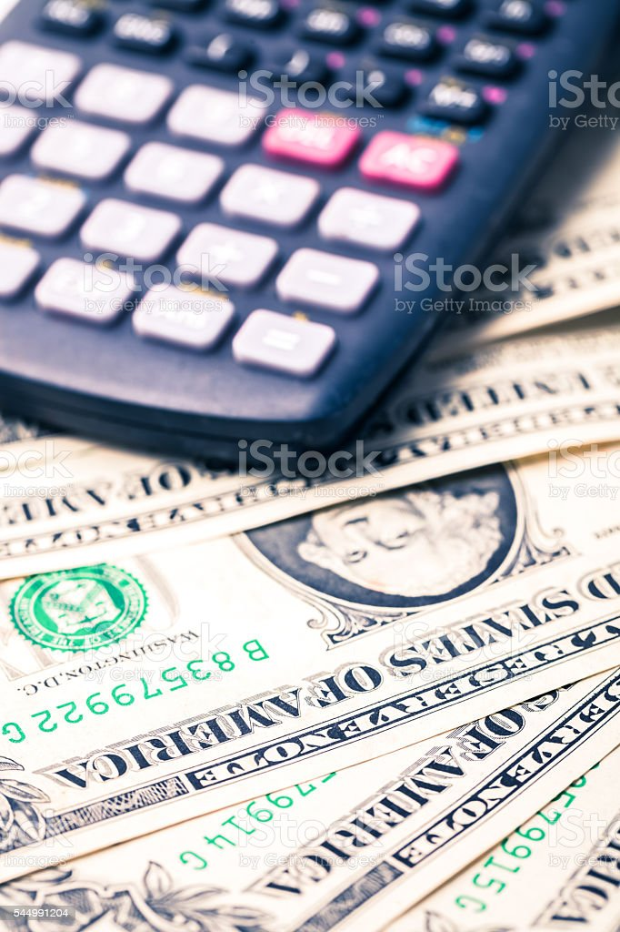dollar background with calculator on top stock photo