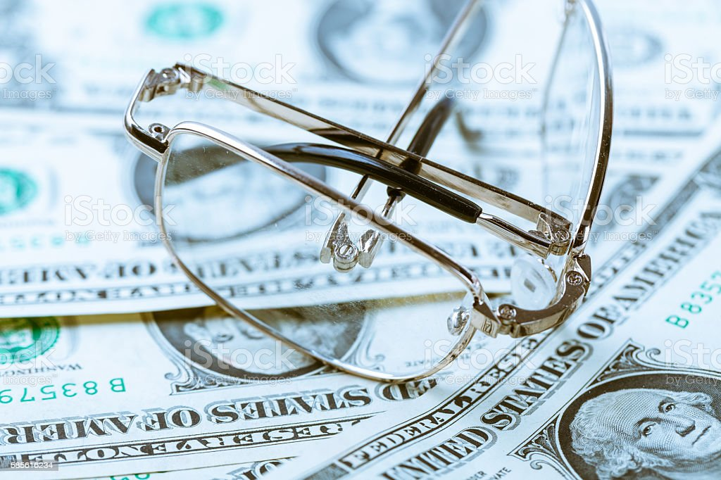 dollar background with glasses on it stock photo
