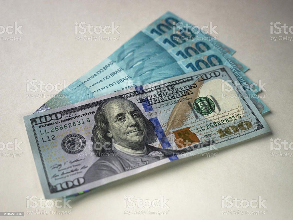 Dollar Bill and Brazilian Currency Bill stock photo