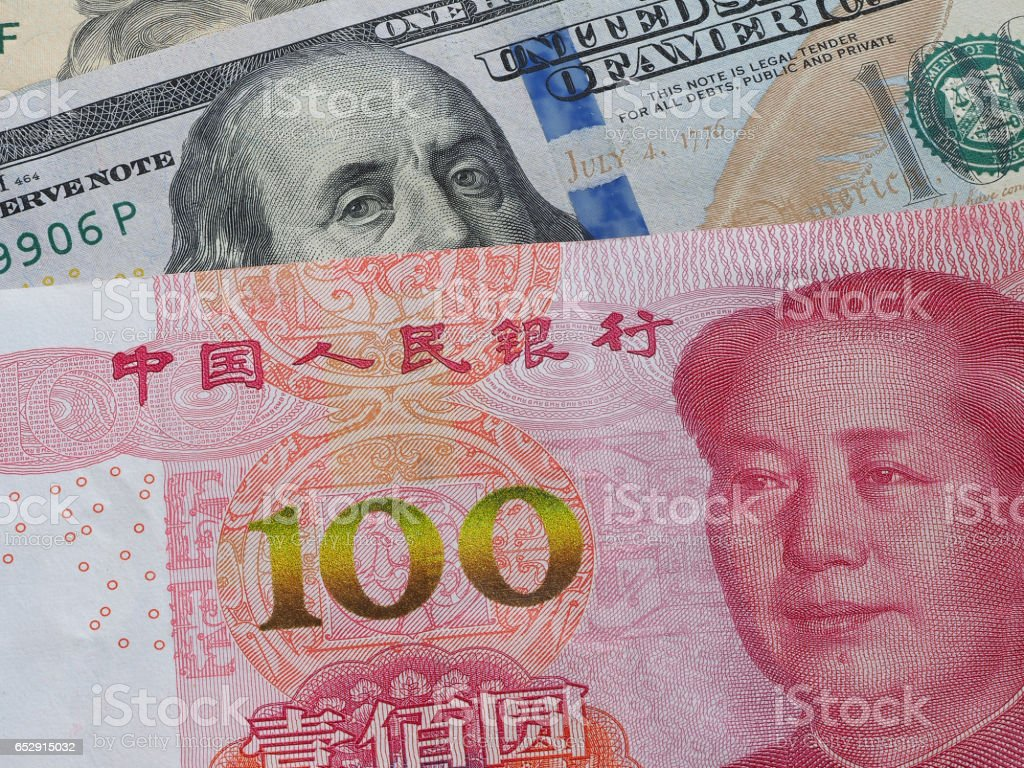 US dollar bill and China yuan banknote macro, Chinese and USA economy finance trade business, money closeup, forex concept. stock photo