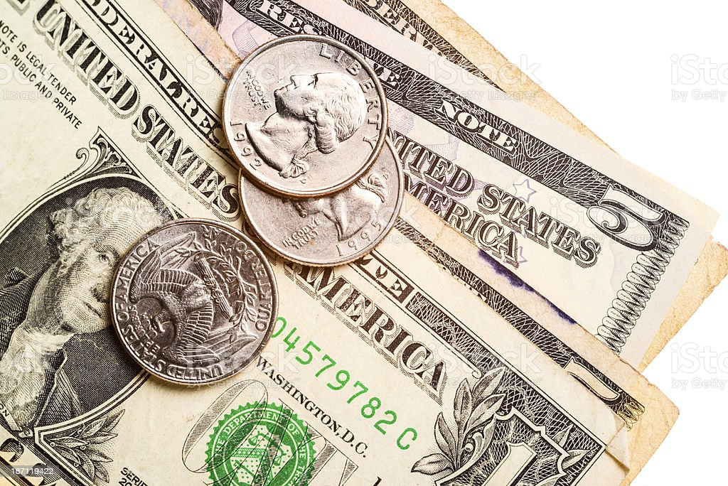 US dollar bills and coins royalty-free stock photo