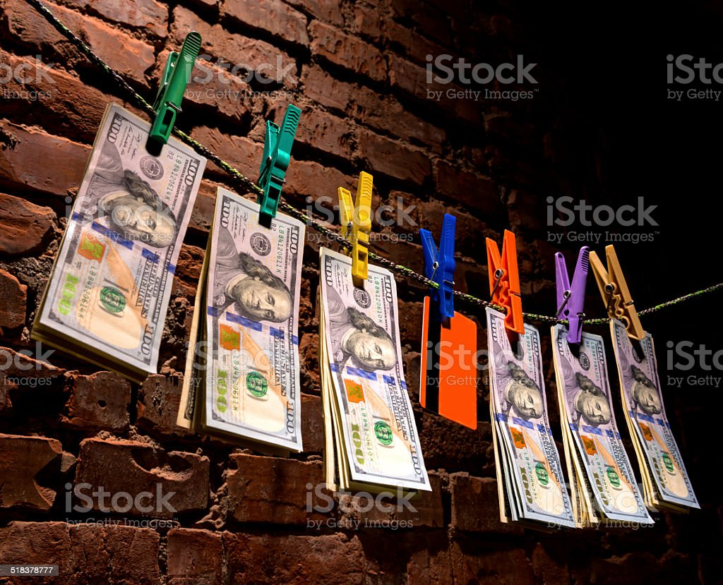 Dollar bills and credit card hanging on a rope stock photo