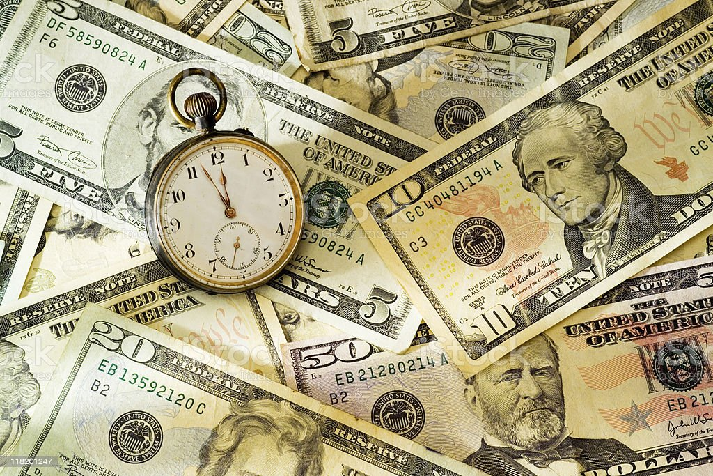 Dollar bills and stopwatch royalty-free stock photo