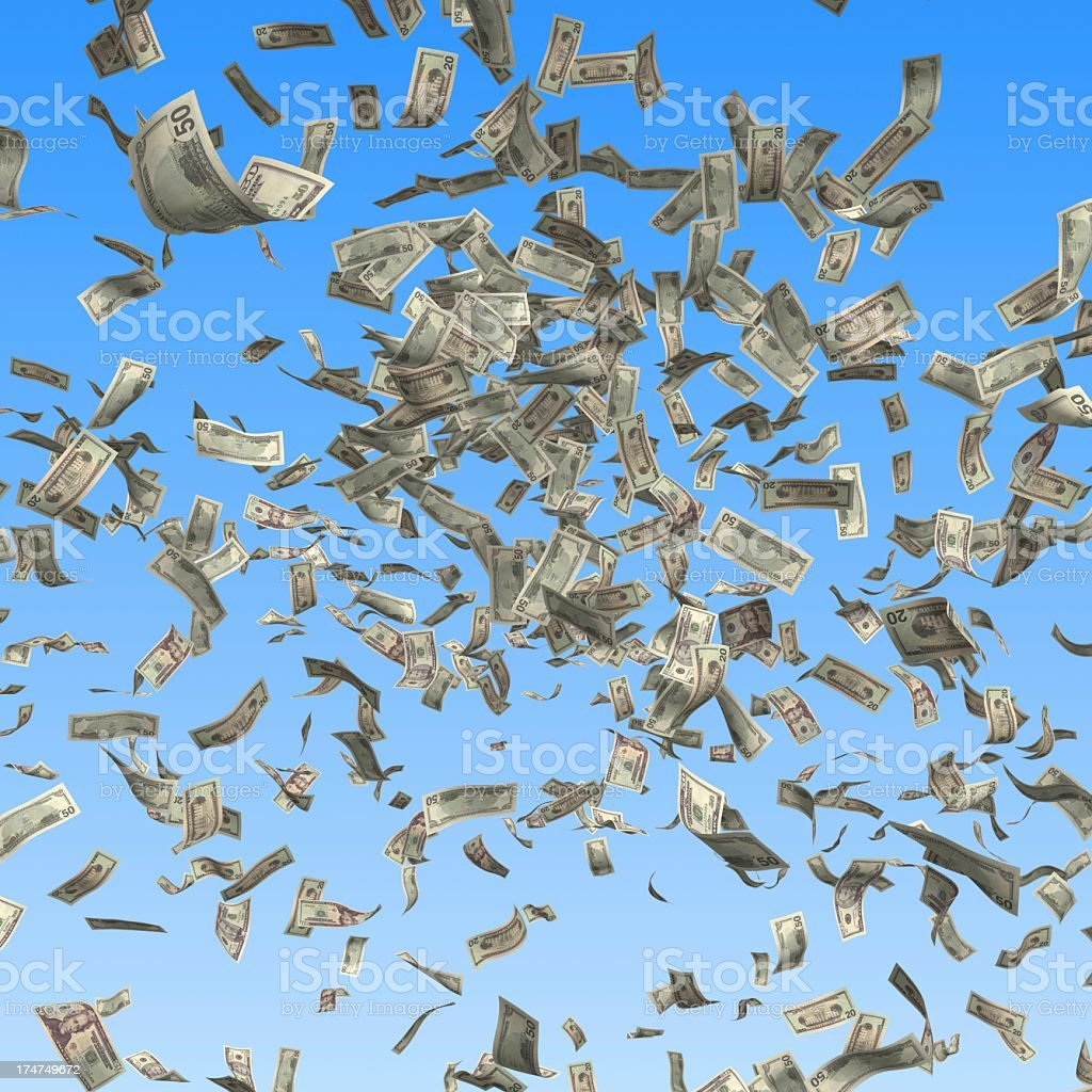 Dollar bills falling from the sky as if it was raining money stock photo