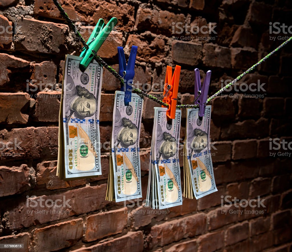 Dollar bills hanging on a rope stock photo