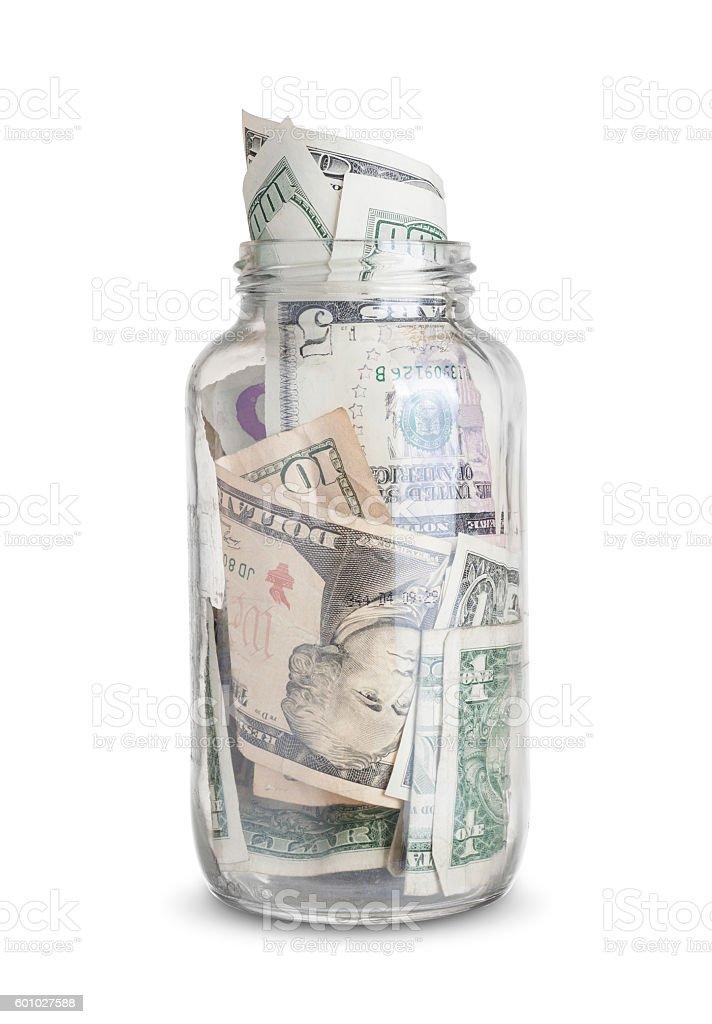 dollar bills in a jar stock photo