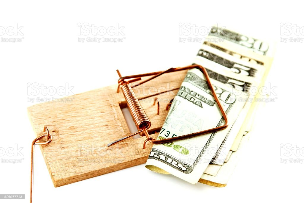 Dollar bills in a mousetrap stock photo